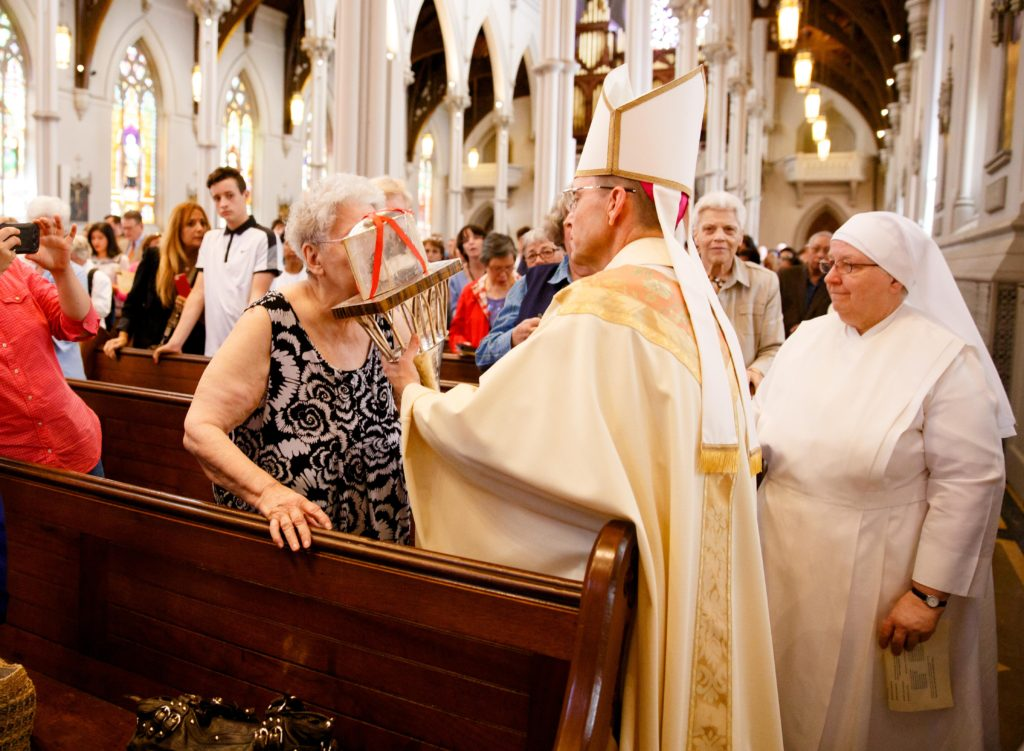 Bishop Robert P. Reed celebrates Mass for the Feast of St. Padre Pio at the Cathedral of the Holy Cross in the presence of the relic of the saint's heart Sept. 23, 2016. Afterwards, the faithful were invited to venerate the relic. Pilot photo/ Gregory L. Tracy